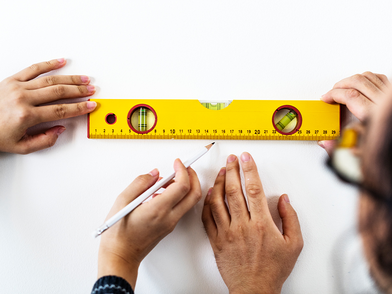 How to Find the Studs in Your Wall Without a Stud Finder